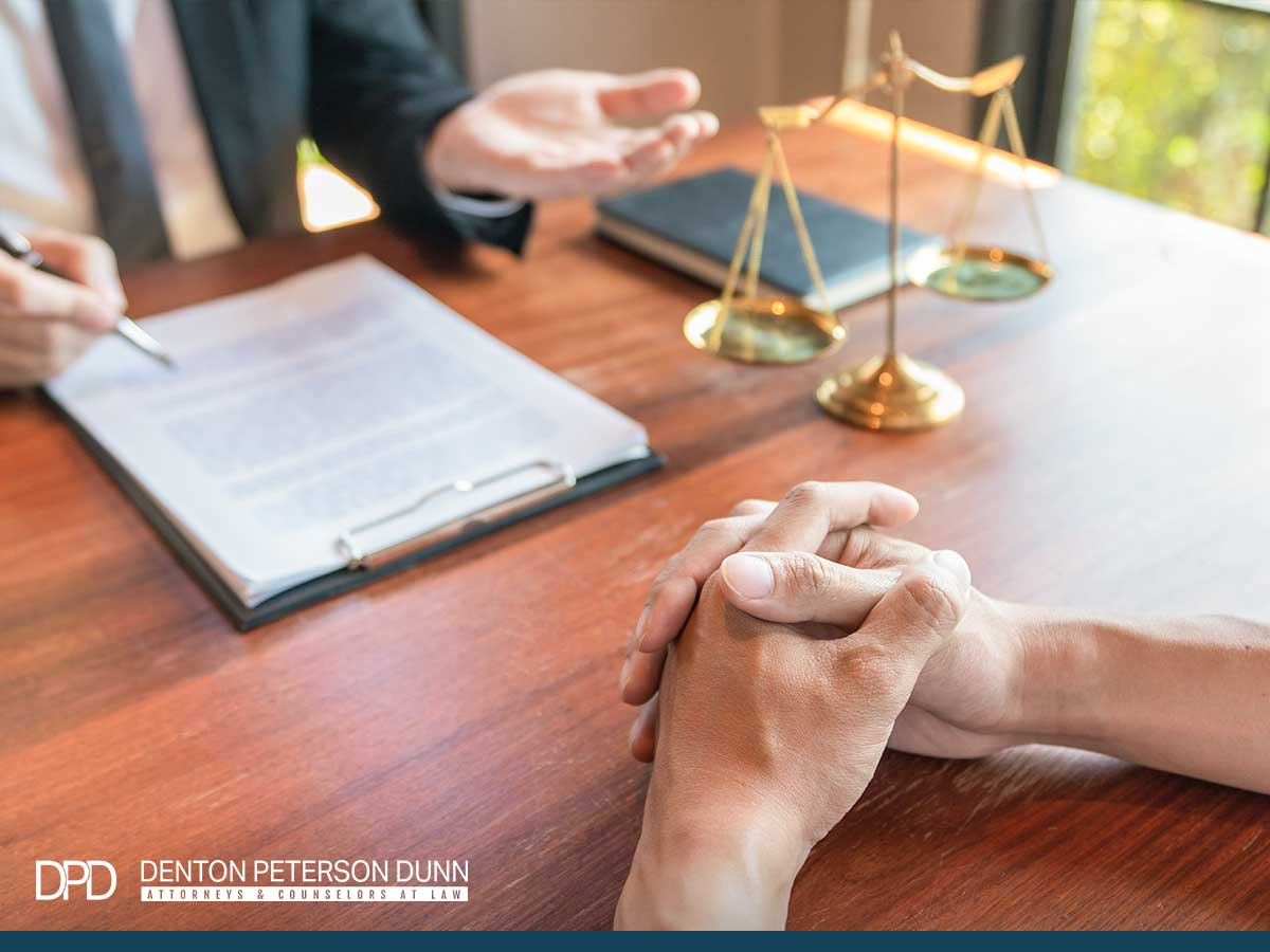A business lawyer explaining a company owner how to prepare for business litigation in Mesa, AZ